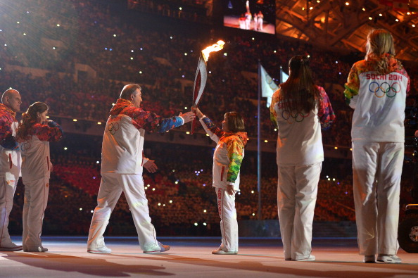 Russian Olympic gold medallists Irina Rodnina and Vladislav Tretyak prepare to take the Olympic Torch to the cauldron outside the Stadium ©AFP/Getty Images