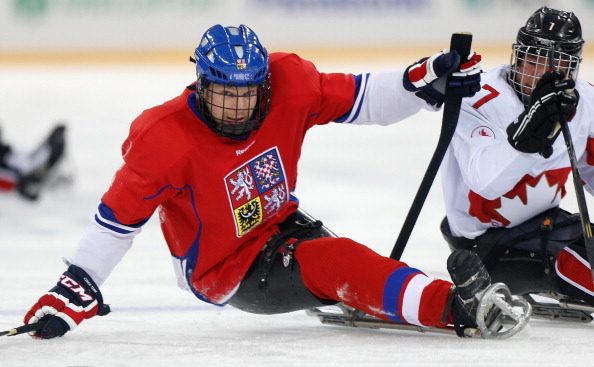 Czech and Canadian players battle it out in the second period of their ice sledge hockey clash ©Getty Images