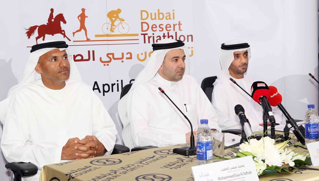 Dubai Equestrian Club deputy general manager Mohammed Essa Al Adhab, and Dubai Sports Council's Nasser Al Rahmah and Adil Yousif Al Bannay launch the first ever Dubai Desert Triathlon ©Dubai Sports Council
