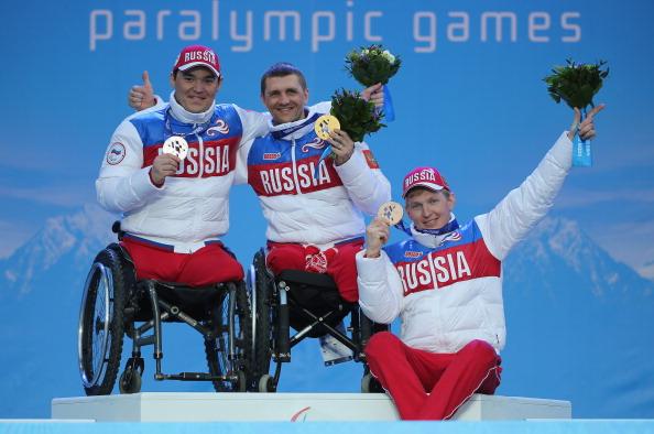 From left, silver medallist Irek Zaripov, gold medallist Roman Petushkov and bronze medallist Aleksandr Davidovich celebrate their Russian 1-2-3 ©Getty Images