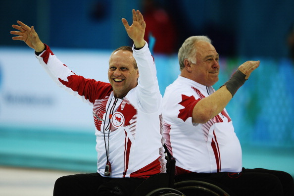 Jim Armstrong and Dennis Thiessen celebrate after winning the gold medal ©Getty Images