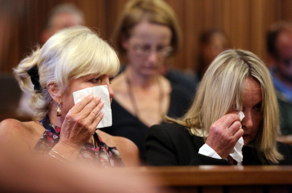 June Steenkamp (right), mother of Reeva Steenkamp, and her her long time friend Jenny Strydom cry as cctv footage is shown of Steenkamp and Pistorius kissing whilst shopping for groceries ©AFP/Getty Images
