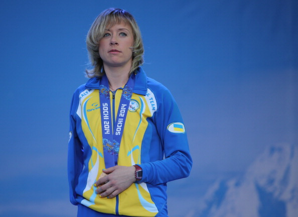 Luliia Batenkova cuts a sombre figure on the medals podium at Sochi 2014 ©Getty Images