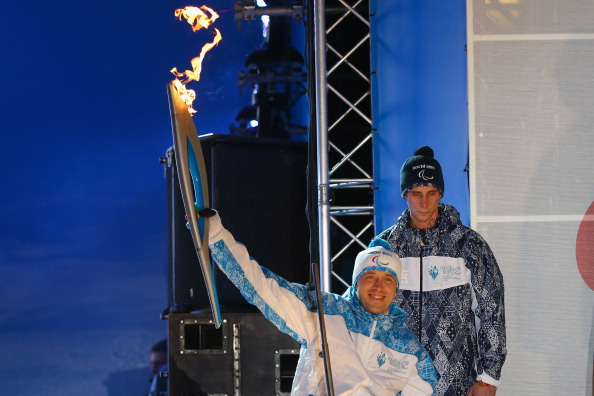 Mikhail Terentyev marks the arrival of the Paralympic Torch to Sochi ahead of the Winter Games ©Getty Images