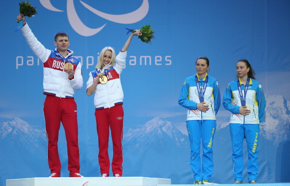 Mikhalina Lysova of Russia and guide Alexey Ivanov celebrate their biathlon gold medal yesterday at this evenings medal presentation ©Getty Images
