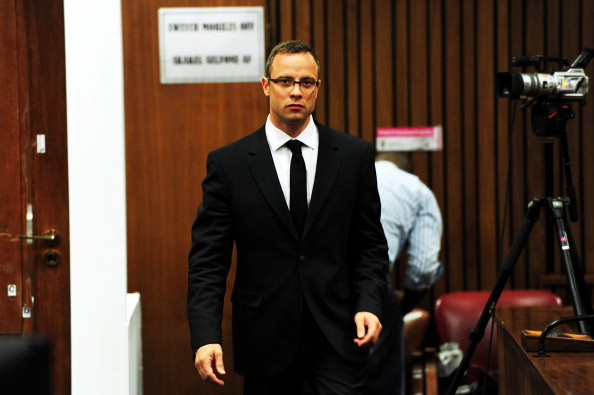 Oscar Pistorius hit Reeva Steenkamp in the hip with the first of four bullets that he fired ©AFP/Getty Images