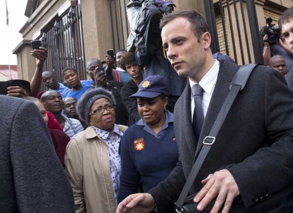 Oscar Pistorius leaving court as attention remains as high as even on day seven of his trial ©Gallo Images/Getty Images