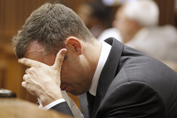 Oscar Pistorius reacts during the fifth day of his trial for the murder of his girlfriend Reeva Steenkamp ©AFP/Getty Images