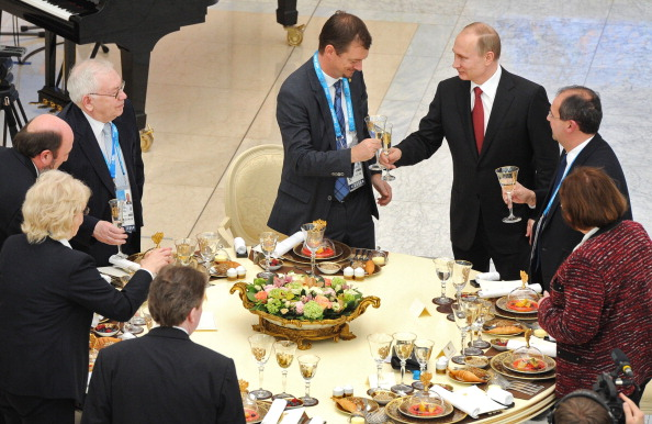 President Putin with IPC members yesterday ©AFP/Getty Images