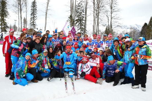 Roman Petushkov poses with volunteers and his six gold medals ©Getty Images