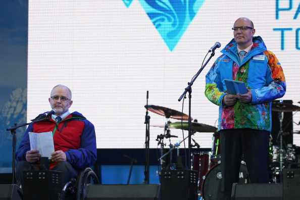 Sir Philip Craven and Dmitry Chernyshenko speak to the crowd at the Sochi lighting ceremony ©Getty Images