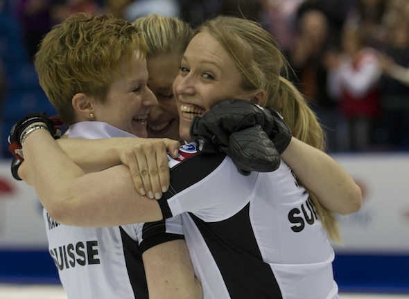 Swiss teammates, from, left Franziska Kaufman, Christine Urech and Irene Schori celebrate their win over South Korea in the semi-final ©CCA/Michael Burns