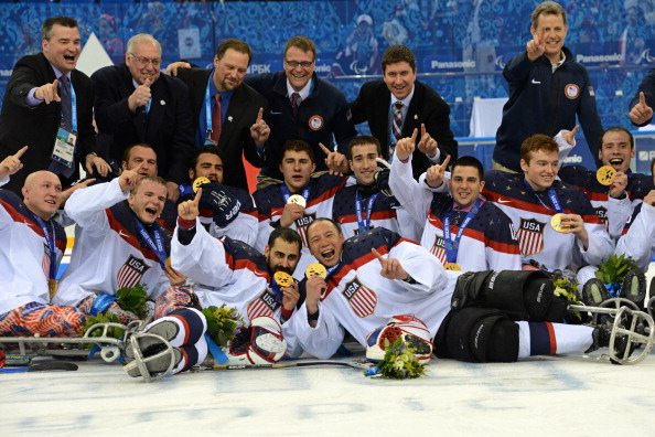 The US team celebrate with their ice sledge hockey gold medals ©AFP/Getty Images