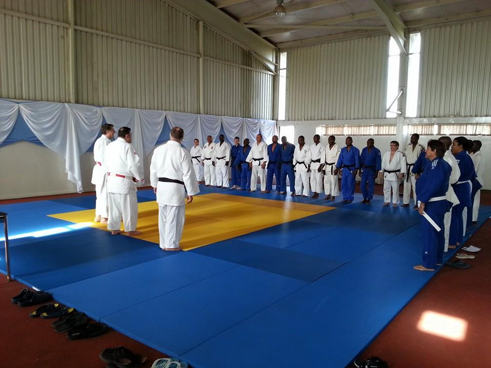 The delegates from each National Federation joined on the tatami by Robert Van de Walle, Alain Massart and Daniel Lascau on day two of the IJF Development Project ©ITG