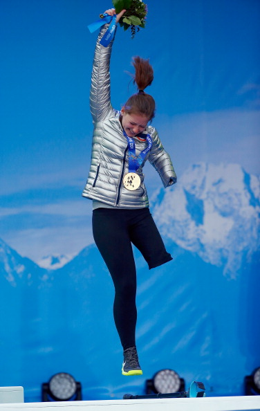 US bronze medal winner Stephanie Jallen leaps onto the podium ©Getty Images
