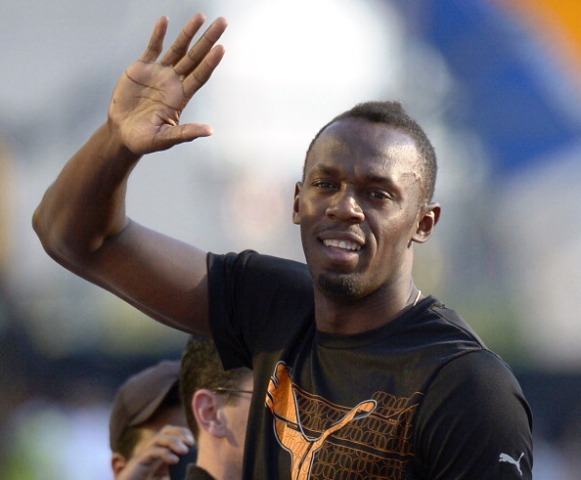 Will Usain Bolt be waving to the crowds inside Hampden Park during this year's Commonwealth Games? ©AFP/Getty Images