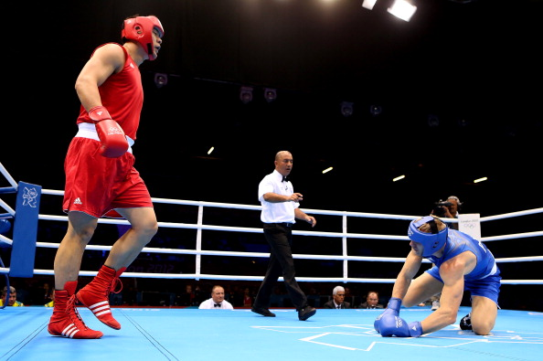 Zhang Zhilei in winning action midway through the London 2012 boxing competition ©Getty Images