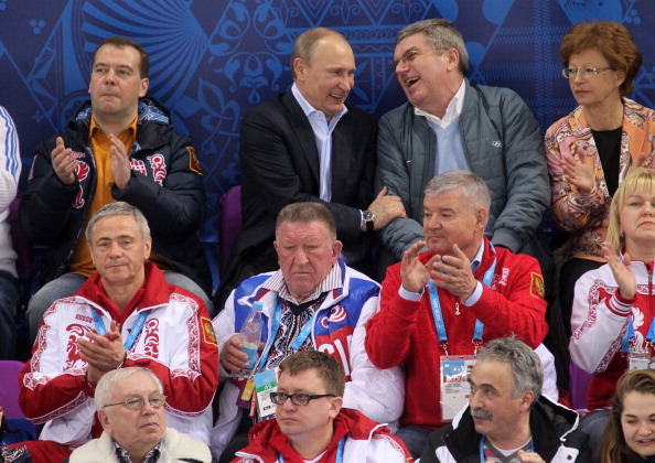Russian President Vladimir Putin, seen here enjoying a joke with International Olympic Committee President Thomas Bach, was not laughing later as his hockey curse struck again ©Getty Images