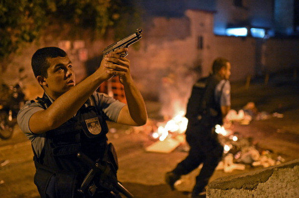 A member of Brazil's special forces police team takes position during a violent protest in Rio de Janeiro ©AFP/Getty Images