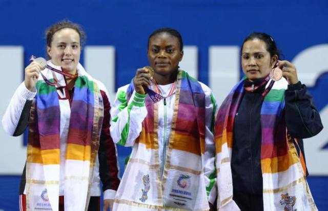 Devi (right) won weightlifting bronze at Delhi 2010 ©Getty Images