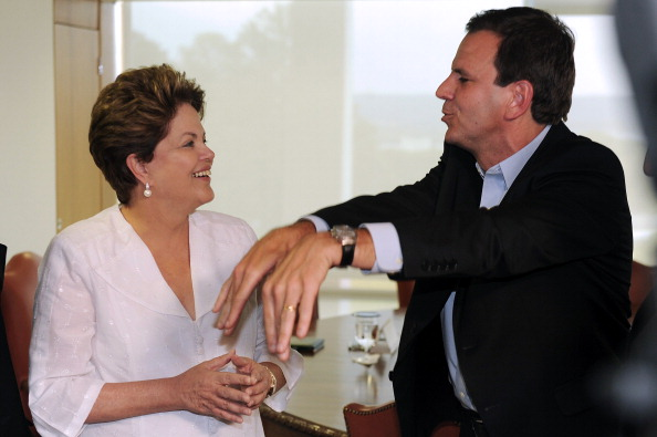 Rio Mayor Eduardo Paes, pictured with Brazilian President Dilma Rousseff, was among those at Copacabana Fort to unveil the infrastructure budget ©AFP/Getty Images