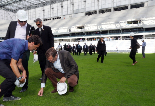 Even the grass at the Arena da Baixada in Curitiba was inspected by Jérôme Valcke as he toured the venue ©AFP/Getty Images