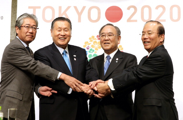 It will be interesting to see how Tsunekazu Takeda (left) will handle delicate decisions he may have to make as chairman of the Marketing Commission ©The Asahi Shimbun via Getty Images