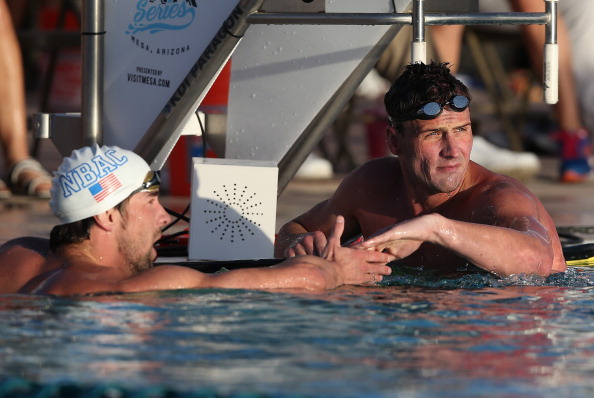 Michael Phelps (left) congratulates compatriot Ryan Lochte after being pipped to the 100m butterfly race win ©Getty Images