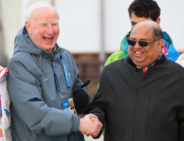 Patrick Hickey shakes hands with newly elected Indian Olympic Association President Narayna Ramachandra uring the welcome ceremony and flag raising at the Olympic Village during Sochi 2014 ©AFP/Getty Images
