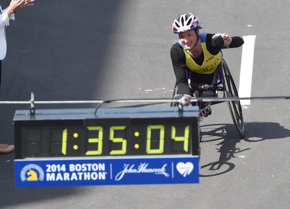 Tatyana McFadden punched the air as she crossed the finish line at the Boston Marathon ©AFP/Getty Images