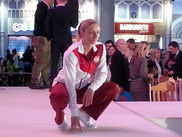Hurdler Louise Wood, who will be hoping to compete at Hampden Park this summer, models the Team England tracksuit ©ITG