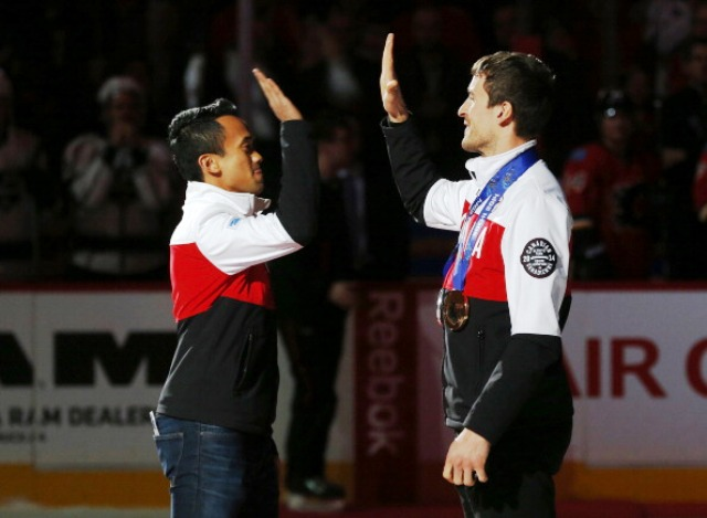 Gilmore Junio (left) allowed good friend Denny Morrison  the chance to skate for Olympic silver at Sochi 2014 ©Getty Images