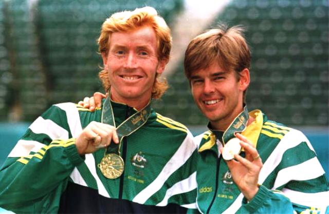 Mark Woodforde (left) and Todd Woodbridge show off their Olympic gold medals after winning in Atlanta in 1996 ©Getty Images