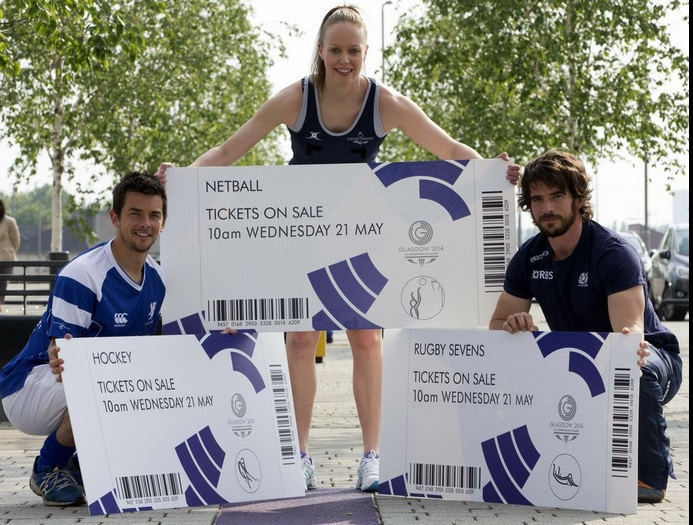 Scotland rugby sevens captain Colin Gregor, Scottish Thistles netball captain Lesley MacDonald and Scotland hockey star William Marshall unveil the first phase of delayed ticket sales ©Glasgow 2014