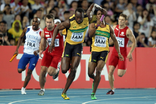 Yohan Blake hands over to Jamaican colleague Usain Bolt in the 2011 IAAF World Championships 4x100m final ©Getty Images