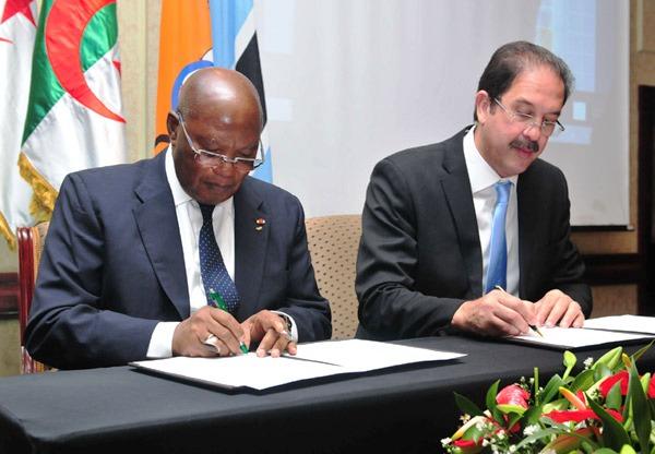 ANOCA President Lassana Palenfo (left) and Algerian NOC President Moustapha Berraf sign African Youth Games hosting agreement ©ANOCA