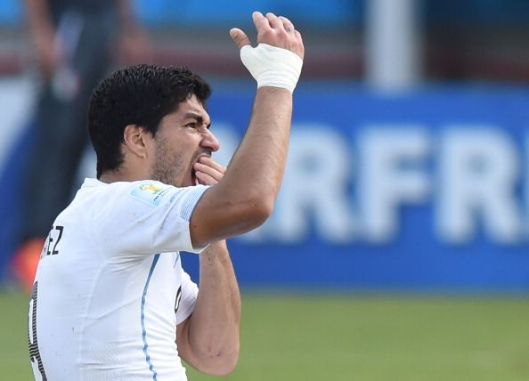 Bowling may not have the same bite as Luis Suárez, but they do have something in common ©AFP/Getty Images