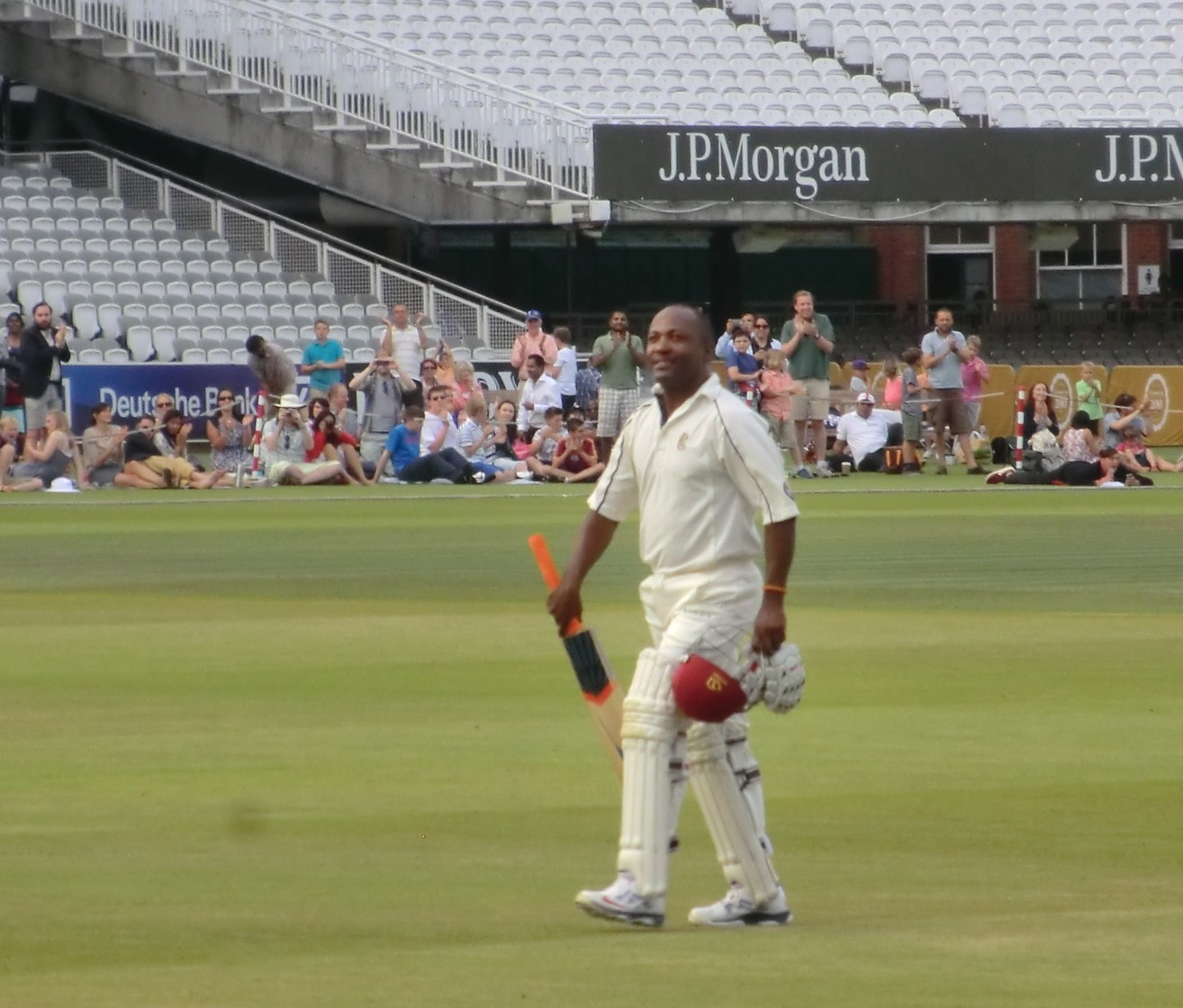 Brian Lara walks in after his blistering performance ©ITG