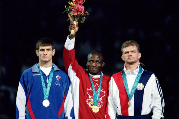 Daniel Igali (centre) won Olympic gold at Sydney 2000 ahead of Russia's Arsen Gitinov and Lincoln McIlravy of the United States ©Getty Images