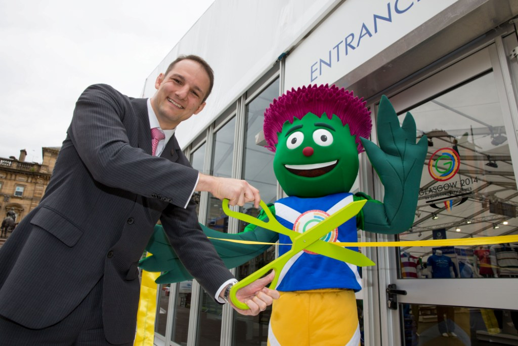 David Grevemberg was joined by Clyde to cut the ribbon at the official opening of the Glasgow 2014 superstore ©Glasgow 2014