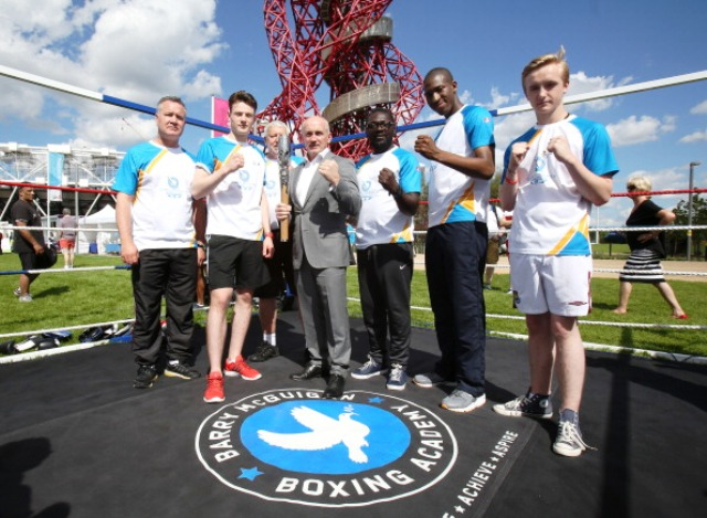 Former Commonwealth Games boxing gold medallist Barry McGuigan (centre) meets six of the Batonbearers in the Olympic Park today ©Getty Images