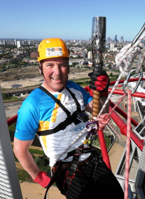 Four-time Olympic rowing champion Matthew Pinsent abseiled down the ArcelorMittal Orbit with the Glasgow 2014 Queen's Baton ©Getty Images
