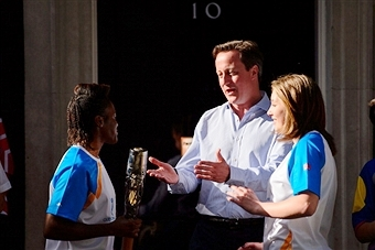 Olympic champion Nicola Adams carried the Queen's Baton into Downing Street where it was welcomed by British Prime Minister David Cameron ©AFP/Getty Images