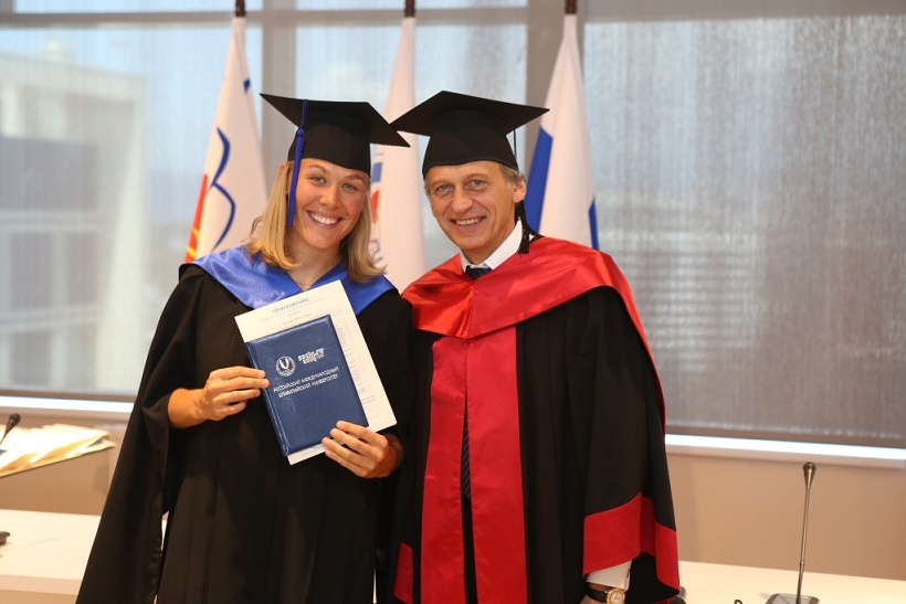 Olympic silver medallist Molly Engstrom recieves her MSA qualification from RIOU Rector Professor Lev Belousov ©RIOU