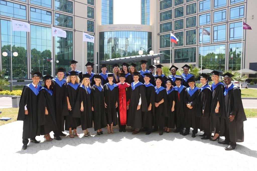 RIOU's first MSA graduates flank RIOU Rector Professor Lev Belousov (centre in red) on RIOU's Sochi-based campus ©RIOU