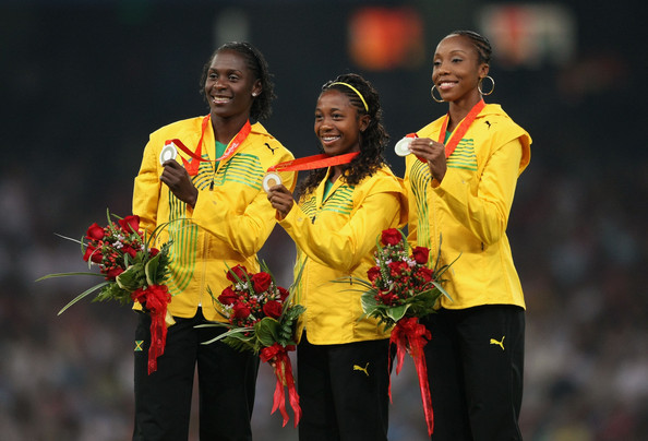 Sherone Simpson (left), celebrating her Olympic 100 metres silver medal at Beijing 2008, has had her drugs ban temporarily lifted by the Court of Arbitration for Sport ©Getty Images