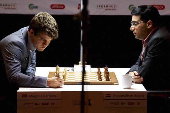 Viswanathan Anand will face Magnus Carlsen is their much anticipated rematch in Sochi ©AFP/Getty Images