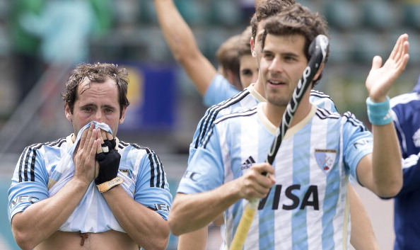 Argentina's men celebrate their 2-0 win over England in the bronze medal match at the Rabobank Hockey World Cup - but the result was subject to protest ©Getty Images