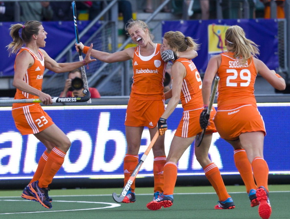 The Dutch women celebrate Xan de Waard's opening goal after two minutes of their semi-final against Argentina ©AFP/Getty Images