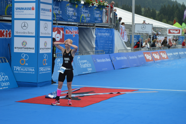 Germany's Nora Hansel reacts with suprise at realising she has won the PT2 event at the European Triathlon Championships in Kitzbuhel ©ETU